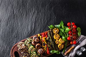 a large portion of colored grilled vegetables and mushrooms on a