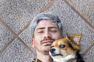 Portrait of a man with his dog