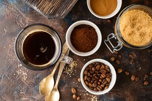 Coffee with coffee beans, ground coffee and brown sugar