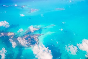Beautiful perfect view of exotic islands and turquoise water from airplane