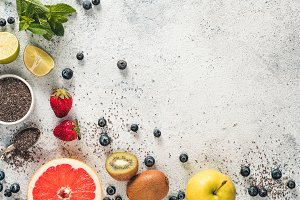 Fresh fruits, berries, chia seeds and mint, copy space