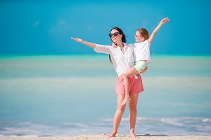 Beautiful mother and daughter on Caribbean beach