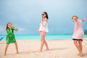 Mother with two kids enjoy beach vacation