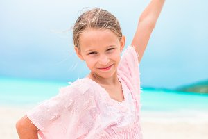 Portrait of beautiful girl on the beach dancing