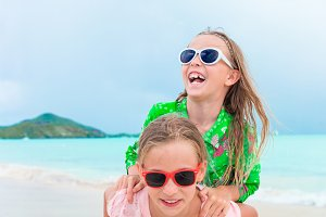 Adorable little girls enjoying time together on the beach