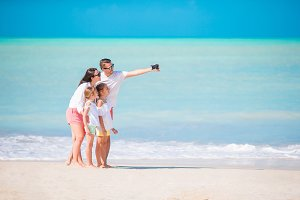 Family on the beach. Family taking photo.