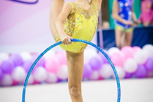 Little gymnast participates in competitions in rhythmic gymnastics