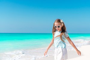 Adorable little girl on tropical beach