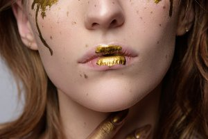 Woman a freckle golden tears on the