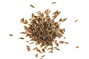 Black Cumin (Bunium bulbocastanum) seeds over white