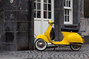 Yellow old style scooter unattended