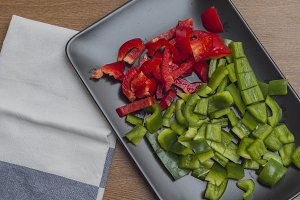 Sliced green and red peppers