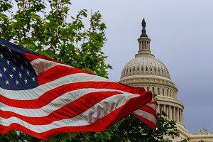 US Capitol building US flag waving