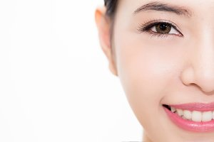 Close-up of Young beauty Asian face focused on eyes, beautiful woman isolated over white background. Healthcare and Eye care concept - with copy space to insert text