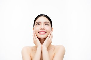 Young beauty Asian face, beautiful woman isolated over white background. Healthcare and Skincare concept