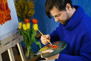 Artist with brushes and palette