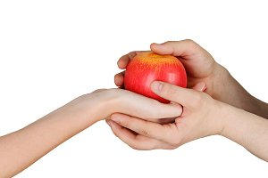 Male and female hands holding apple