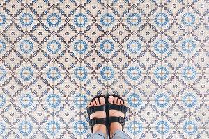 Selfie feet in sandal shoes on floor