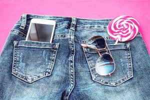 blue jeans with lollipop and mobile