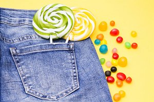 blue jeans with lollipop and candies