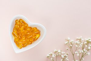 omega-3 pills in a heart-shaped dish