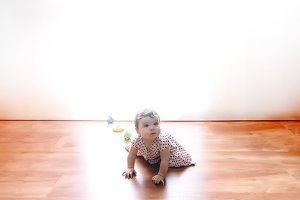 Eight month old toddler girl crawlin