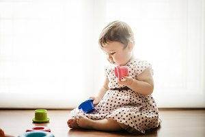 Eight months old toddler girl playin