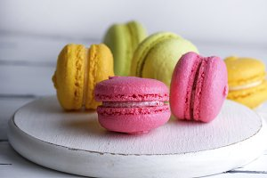 macarons on a white wooden board