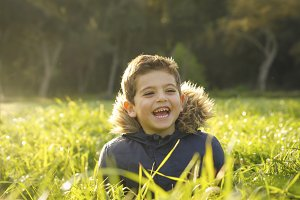 Boy smiling in a field