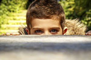 Boy peeking over a table