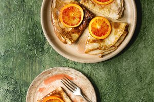 Pancakes with bloody oranges