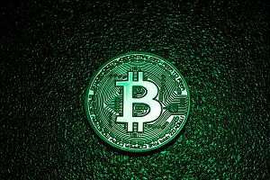 A coin with bitcoin logo in a green