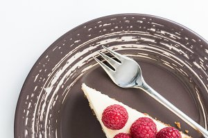 Cheesecake with raspberries isolated