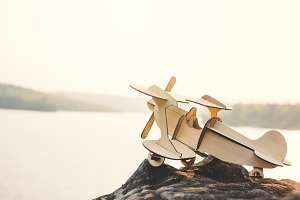 Wooden plane on the rock
