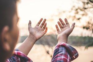 hands praying on nature