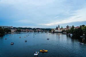 Touristic boats on River against Prague cityscape