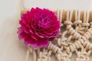 macrame wall art with pink dahlia