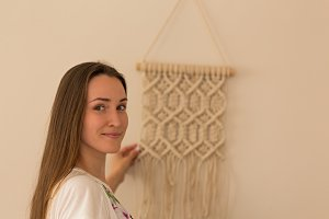 artist with her macrame wall art