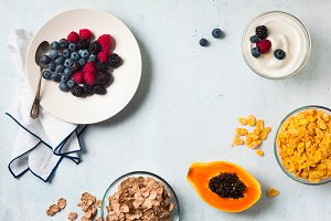 breakfast with berries, yogurt, flak