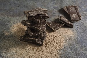 pieces of dark chocolate stacked on
