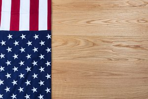 Folded USA Flag on Oak Background