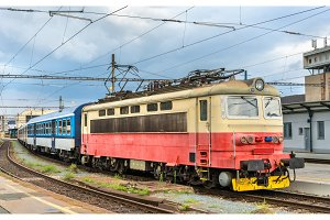 Old electric locomotive with a passenger train at Brno station, Czech Republic