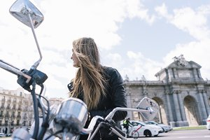 Woman with a motorcycle in the city