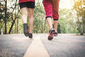 Feet man and woman running