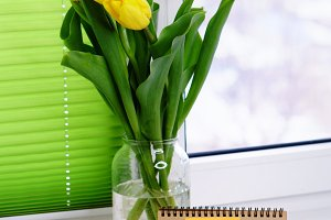 Yellow tulips and cup of coffee