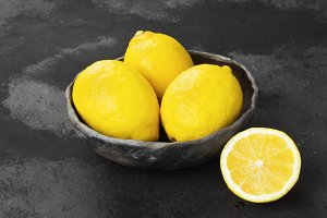 Lemons in clay bowl