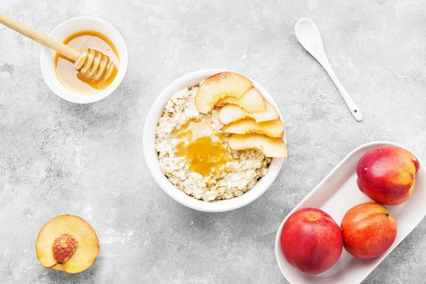 Food Stock Photos - Oatmeal with nectarine and honey