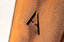 Letter A engraved on a rusty plate 3