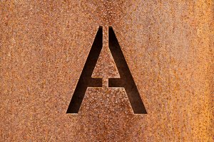 Letter A engraved on a rusty plate 1