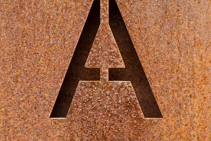 Letter A engraved on a rusty plate 2